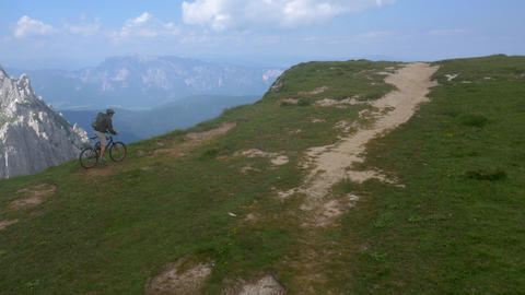 Aerial - Mountain biker riding on plateau top Live Action