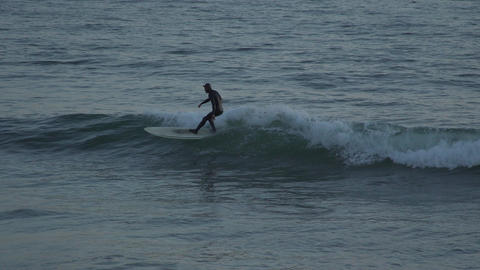 Surfers Dramatic bob in the ocean near Mesa Beach Footage