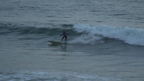 Surfer rides wave near Mesa Beach Footage