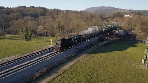 Aerial - Steam engine train crossing the bridge Footage