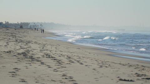 People walking along beach near the Santa Monica Pier Footage