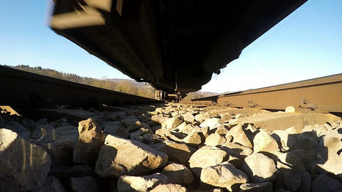 Rail track POV - Undercarriage of moving train, slow motion Footage
