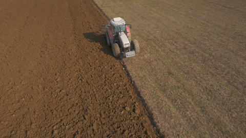 Aerial - Loosening and aerating top layers of soil with a tractor Footage