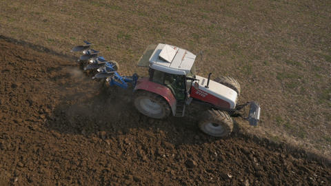 Aerial - Tractor plowing a field. A first step in cultivating the land Footage