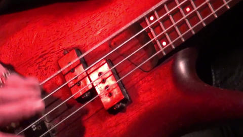 bass guitar in live action at a concert - rack focus - close up Live Action