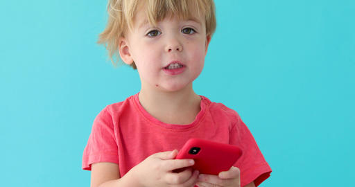 Child tapping cell phone screen, interest in modern technology Footage