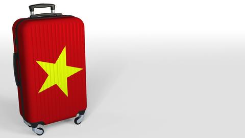 Traveler's suitcase with flag of Vietnam. Vietnamese tourism conceptual 3D Footage