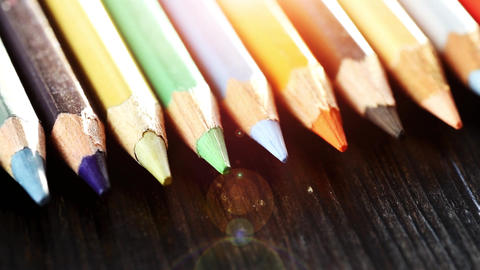 On a wooden background multi-colored pencils. Bright colored pencils Close up ライブ動画