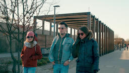 Three Young Adult Friends are Talking and Walking on Modern Quay in Sunny Day Footage