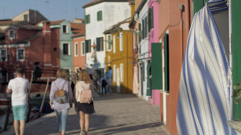 A blurred scenery of italian Burano with walking tourists Footage