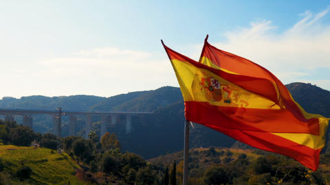 Teared up Spanish flag waving in slow motion Archivo