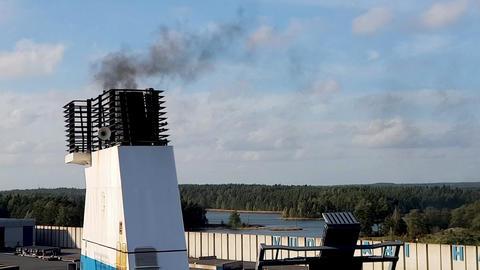 HELSINKI, FINLAND - APRIL 6, 2019: Finnlines ferry in Vuosaari harbor. Smoke Archivo