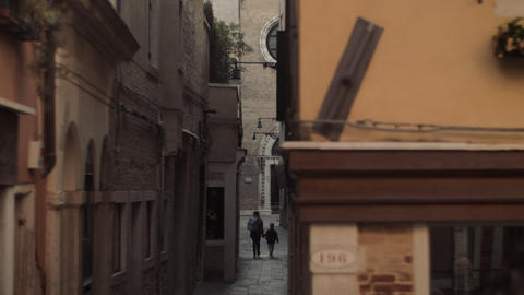 A narrow Venice street with stone facades and a paved cover Live Action