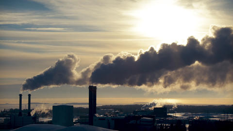 Smoking factory chimneys. Environmental problem of pollution Live Action