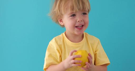 Little Funny boy in shirt keeps lemons Footage
