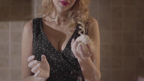 Portrait passionate woman in black dress smeared with flour mixing dough in Live Action
