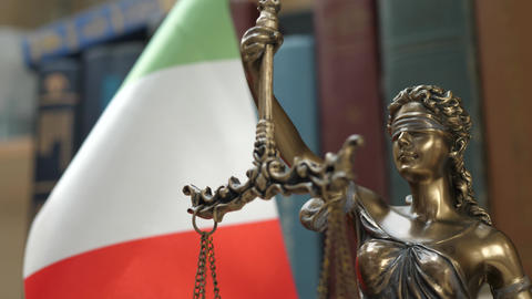 Statue of Lady Justice with Bookshelf with Books and Italy Flag Background Footage