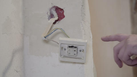 Light switch hanging on the cable Live Action