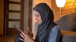 Closeup shoot of young attractive muslim female in hijab typing on the phone Footage