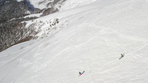 Aerial View of Snowboarders freeride in Winter Mountains Footage