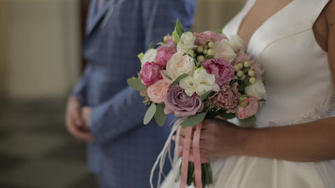 Wedding bouquet in the hands of the bride. Wedding day. Slow motion Footage