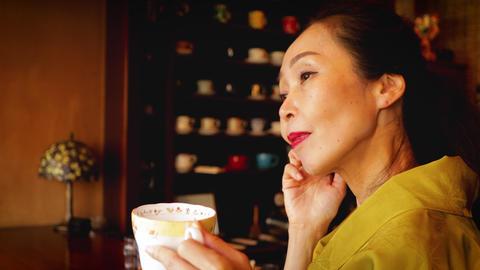 Elegant Japanese woman enjoying a coffee GIF
