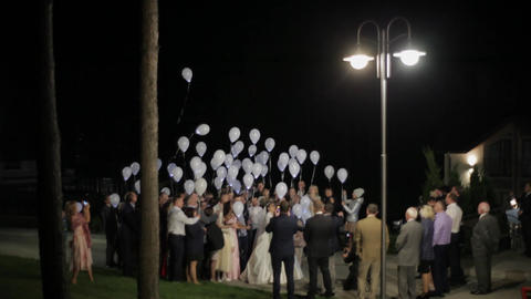 Blinking helium balloons flying at night sky. Balloons in wedding party Live Action