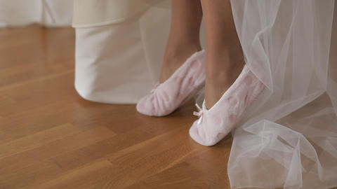 Beautiful and lovely bride in funny slippers. Close-up shot of woman legs Live Action