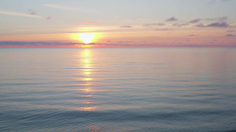 Golden sun in evening sky while sunset in sea aerial landscape. Colorful sunrise in morning sky and Live Action