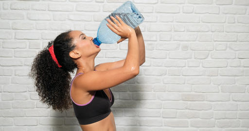 Athlete Young Woman Drinking Water From Bottle For Sport Fitness GIF