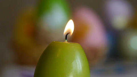 Candles made in shape of easter egg. Burning candles. Green candles extinguished Live Action