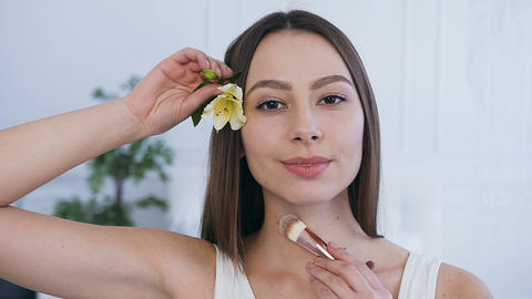 Portrait shot of smiling beautiful woman with flower in the hair Footage