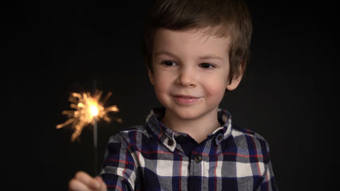 Happy adorable boy holding a sparkler Footage