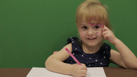 Girl sitting at the table. Education process. Cute girl smiling. Chroma Key Footage