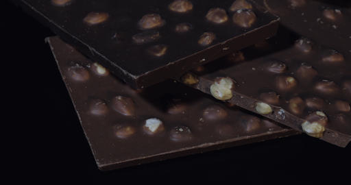 Dark chocolate blocks with nuts details slow close-up macro. Chocolate bars Footage