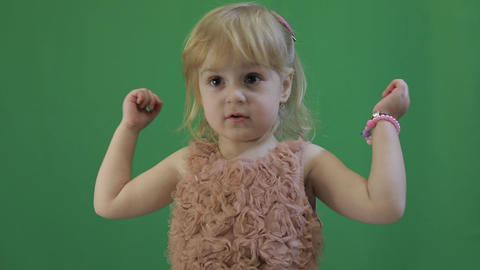 Happy three years old girl. Cute child. Dancing and make faces. Chroma Key Footage