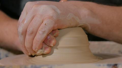 Professional male potter working with clay on potter's wheel Footage