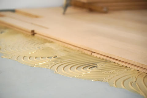 Pad applied with glue for parquet Photo