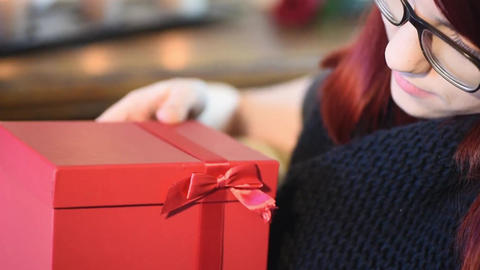 Valentine Gift. Young Girl opening red gift box Footage