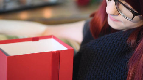 Valentine Gift. Young Girl opening red gift box Stock Video Footage