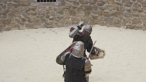 warrior strikes with a sword on the enemy's helmet Accelerated shooting Live Action