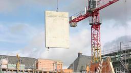 Construction Crane Hoisting Concrete Panel Live Action