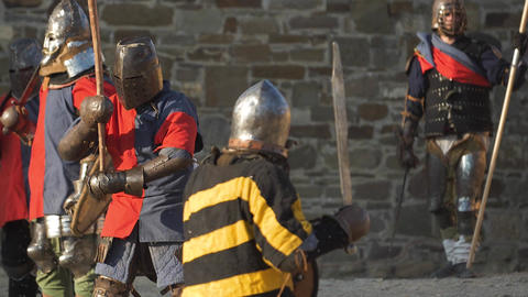 Red command of knights in armor to defend the castle from invaders Live Action