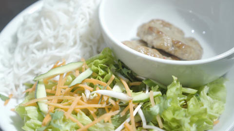 Cutlets lying in the bowl on the plate near noodles and vitamin salad of carrot Footage