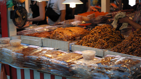 Street food at the Asian night market. Traditional Thai dishes are sold in the GIF