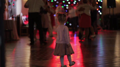 Little child watching adults dance in the patry. Feel enthusiastic Archivo