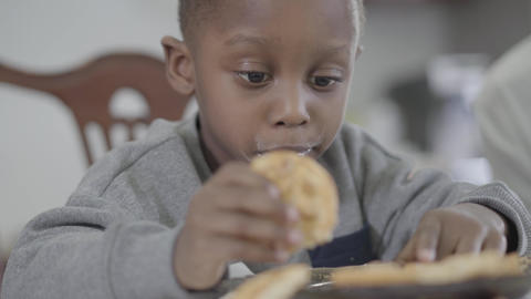Portrait of cute african american child boy with dirty lips after milk playing Footage