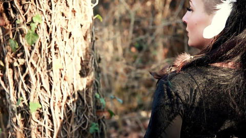 Beautyful Viking woman conjures a tree and nature Live Action