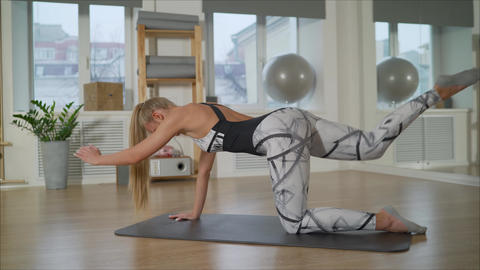 Athletic girl doing pilates in the cozy gym. Beautiful young girl pilates Footage
