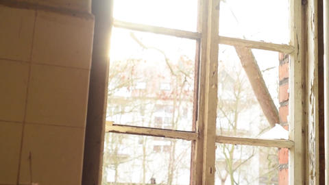 Old abandoned window with sunlight shining Footage